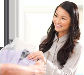 girl taking coat hanger