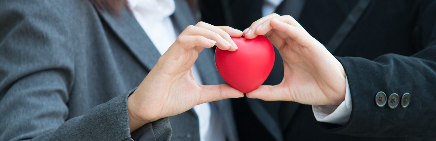 people holding a heart